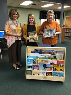 thank you to Spirit Bank and its patrons for the wonderful donation of a book  display and books to our library from Spirit's Dream Big campaign